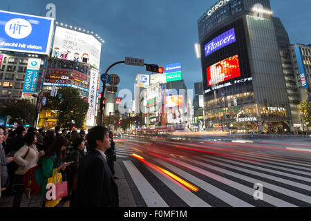 Neon signs and pedestrian crossing (The Scramble) at night, Shibuya Station, Shibuya, Tokyo, Japan, Asia - Stock Photo