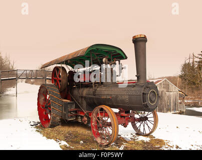 old steam engine on the shore of the Erie Canal, Camillus, New York in winter - Stock Photo