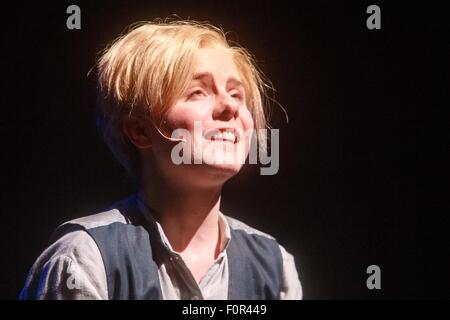 Hamburg, Germany. 19th Aug, 2015. Actress Carolin Waltsgott as 'Oliver Twist' performs on stage during the photo - Stock Photo