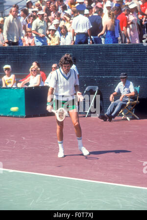 Tom Gorman in action at tennis tournament in September 1974. - Stock Photo