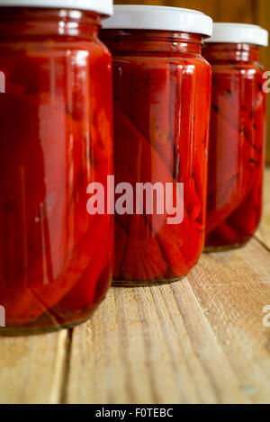 red peppers in a glass jar - Stock Photo