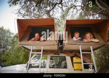 Family in sleeping tents on top of off road vehicle, Ruacana, Owamboland, Namibia - Stock Photo