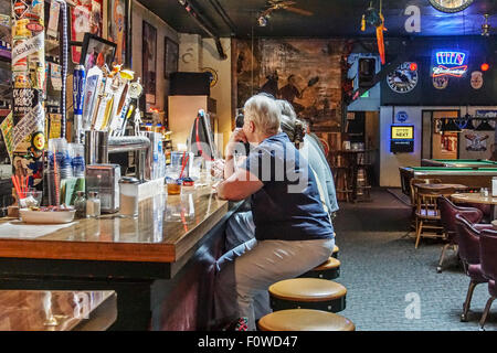 People Sitting At Bar On Stools Inside Prost 4237 N
