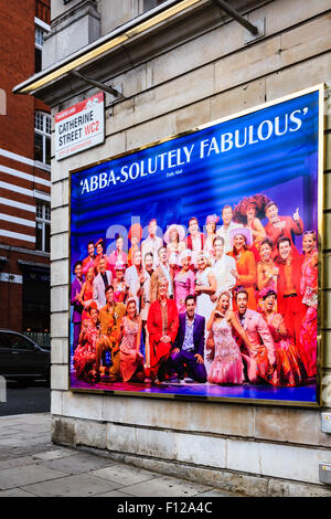 'Abba-solutely fabulous' review poster on wall of Catherine Street for Mamma Mia musical at Novello Theatre in London's - Stock Photo