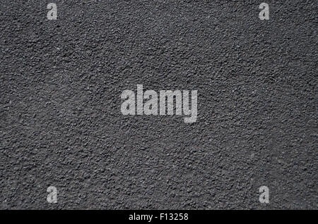 A close up view of a road surface, suitable for use as a background or texture. - Stock Photo