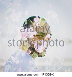 Digital composite of man and flowers - Stockfoto