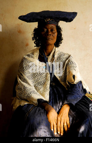 Herero woman in traditional dress - influenced by Victorian missionaries, Kaokoland, Namibia. February 2005 - Stock Photo
