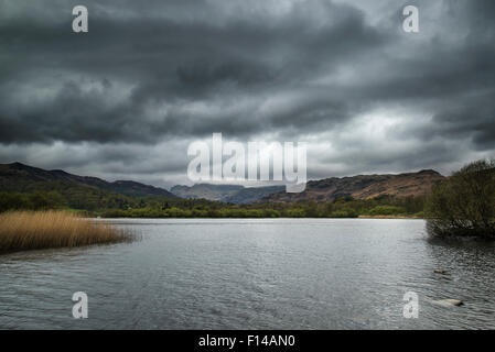 Stormy dramatic sky over Lake District landscape in England - Stock Photo