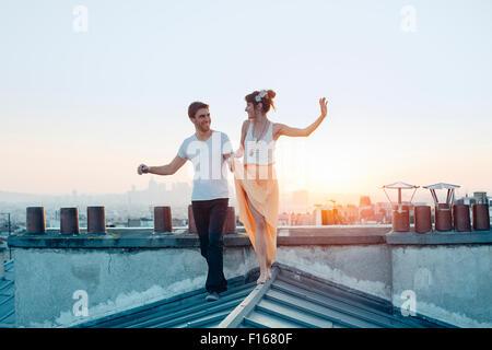 Paris, Couple walking on paris's roofs - Stock Photo