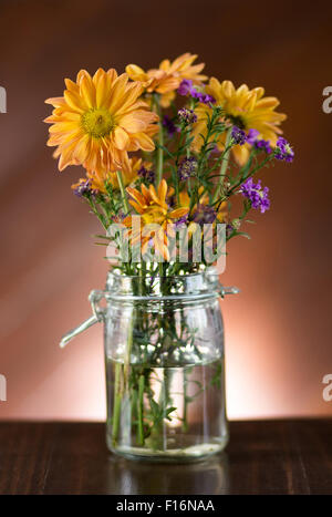 beautiful flower in vase on table - Stock Photo