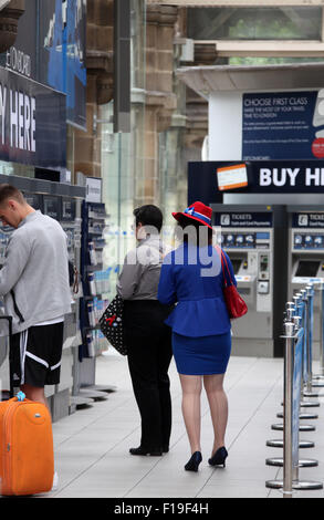 Woman dressed in patriotic British costume at Sheffield railway station - Stock Photo