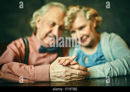 Close-up of hands of affectionate seniors - Stock Photo