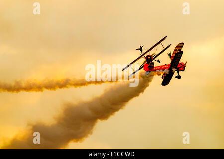 AeroSuperBatics as the Breitling Wingwalkers, a British aerobatics and wingwalking team - Stock Photo