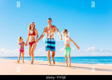 Family vacation. Happy family having fun on beautiful warm sunny beach. Summer lifestyle - Stockfoto