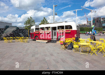 Pop-up cafe in a bus in Granary Square, Kings Cross, London - Stock Photo