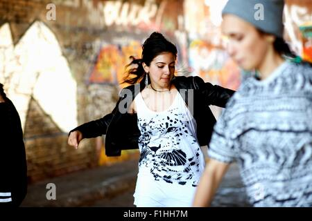 Young women dancing in the street - Stock Photo