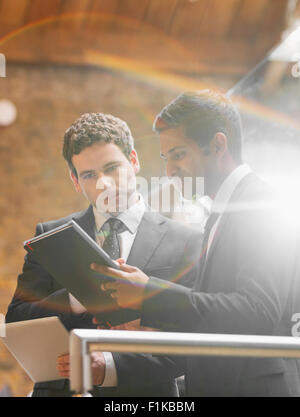 Businessmen working with digital tablet in office - Stock Photo