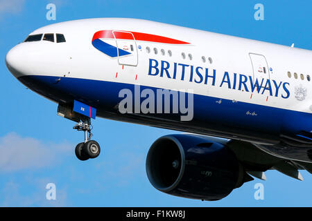 British Airways Boeing 777-200 approaches runway 27L at London Heathrow airport. - Stock Photo