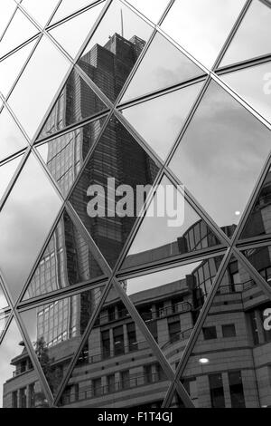 Triangle shaped abstract from window reflections of a modern office building - Stock Photo