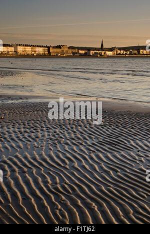Low tide on Weymouth Beach in Dorset, England, UK - Stock Photo