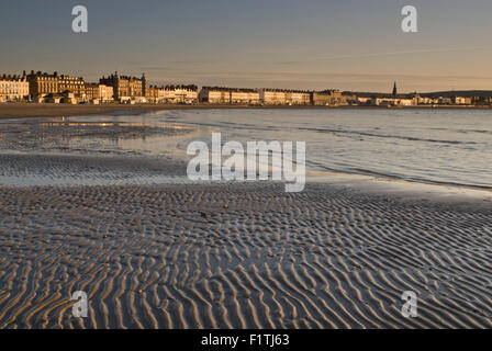 Low tide on Weymouth Beach in Dorset, England, UK - Stock Photo