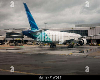 A Boeing 777 of Garuda Indonesia airlines, registration PK-GIA, at London Gatwick Airport - Stock Photo