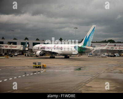 Caribbean Airlines 767, registration 9Y-LGW, at gate 48R of London Gatwick Airport, North Terminal - Stock Photo