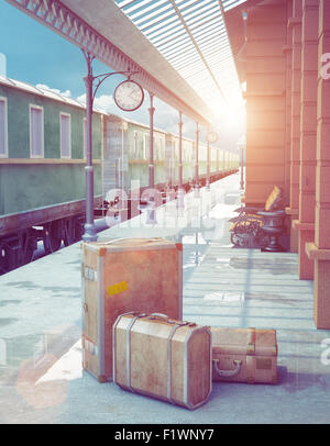 A set of vintage luggage consisting of old leather cases,  on the platform of a retro railway station - Stock Photo