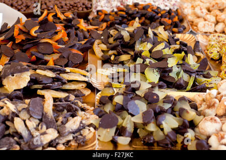 Candy with chocolate inside a wicker basket - Stock Photo