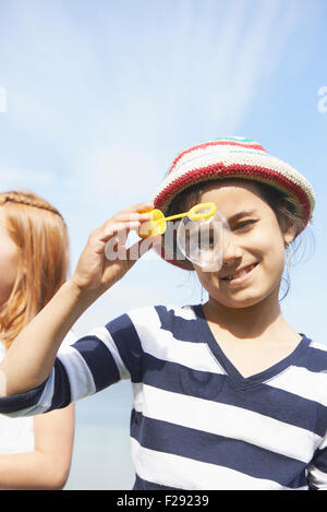 Girl looking through a bubble, Bavaria, Germany - Stock Photo