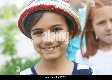 Portrait of a girl smiling, Bavaria, Germany - Stock Photo