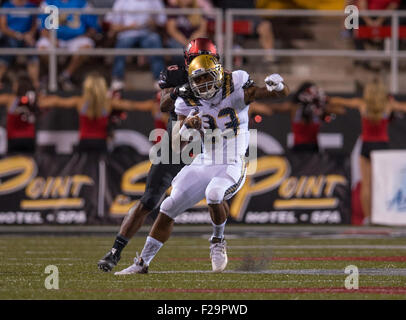 Las Vegas, NV, USA. 12th Sep, 2015. UCLA Bruins running back (23) Nate Starks tries to break free of an attempted - Stock Photo