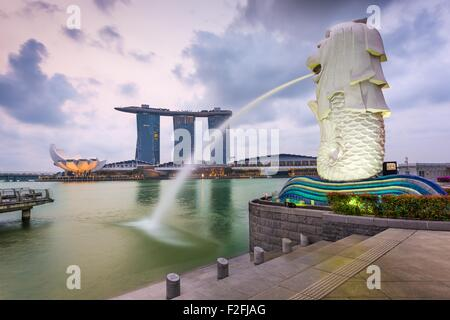 The Merlion fountain at Marina Bay. The merlion is a marketing icon used as a mascot and national personification - Stock Photo