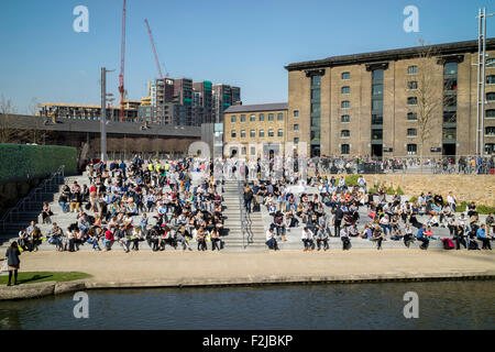New steps down to the Regent's Canal in front of the redeveloped Granary Square near King's Cross in London - Stock Photo