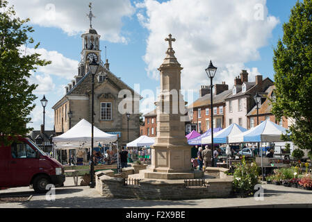 War Memorial and Georgian Town Hall, Market Place, Brackley, Northamptonshire, England, United Kingdom - Stock Photo