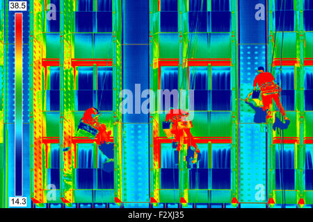 Infrared thermovision image Three climbers wash windows - Stock Photo