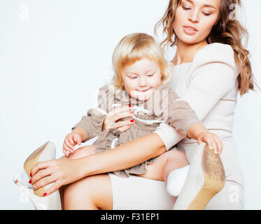 pretty real fashion mother with cute blond little daughter - Stock Photo