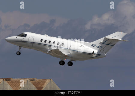 A Private Hawker 800XP taking off from runway 31. - Stock Photo