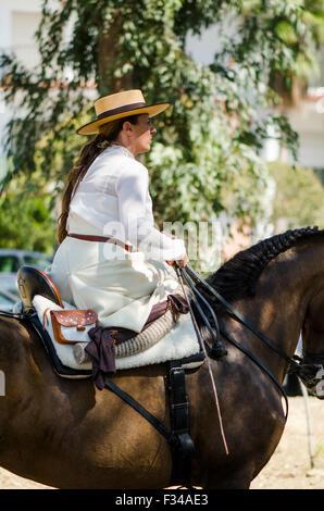 Woman in traditional spanish dress, catholic pilgrimage, romeria Virgen del Rosario, Fuengirola, Andalusia, Spain. - Stock Photo