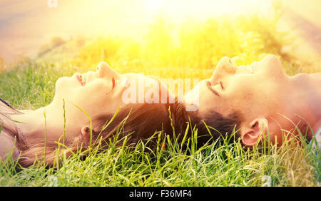 Young happy couple lying in the sun - Stock Photo