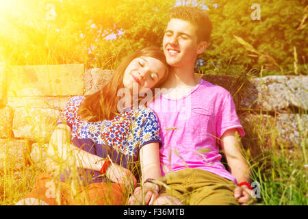 Young happy couple dreaming in the sun - Stock Photo