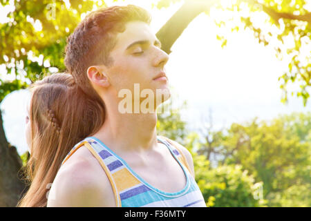 Young couple dreaming - Stock Photo