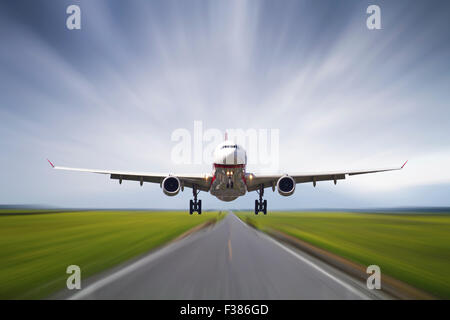 Big jet plane taking off runway with motion take - Stock Photo