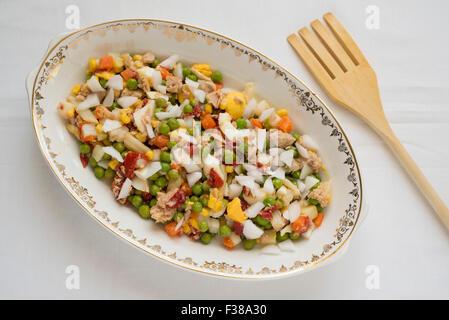 Tuna salad, boiled egg and peas - Stock Photo