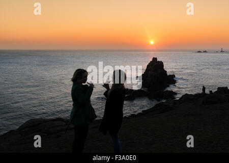 Lands End, Cornwall, UK. 2nd October 2015. UK Weather. The sun sets over lands end after another hot and sunny day - Stock Photo