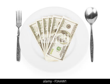 dollars on a white plate with a fork and spoon isolated on white background - Stock Photo