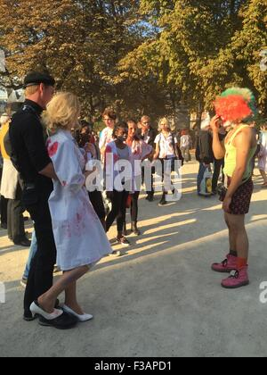 PARIS, FRANCE, 3rd October, 2015.  A group of all ages gather for the annual zombie walk. Credit:  Scott Carson/Alamy - Stock Photo