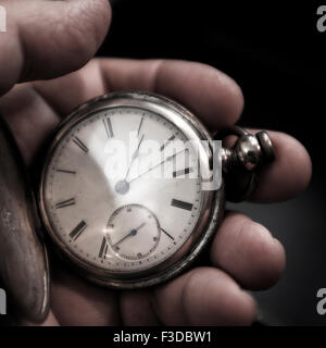 Pocket watch in man's hand - Stock Photo
