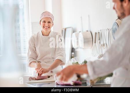 Chefs working in kitchen - Stock Photo