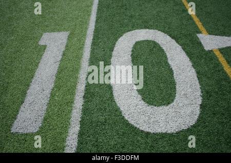 Football field marking of 10 yard line - Stock Photo